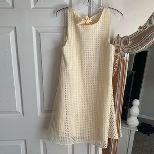 Cream dress with adorable bow detail on back
